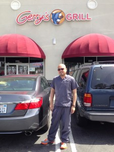 The Boss in Scrubs: Ray Mangune poses in front of his pride and joy Gerry's Grill in Artesia.
