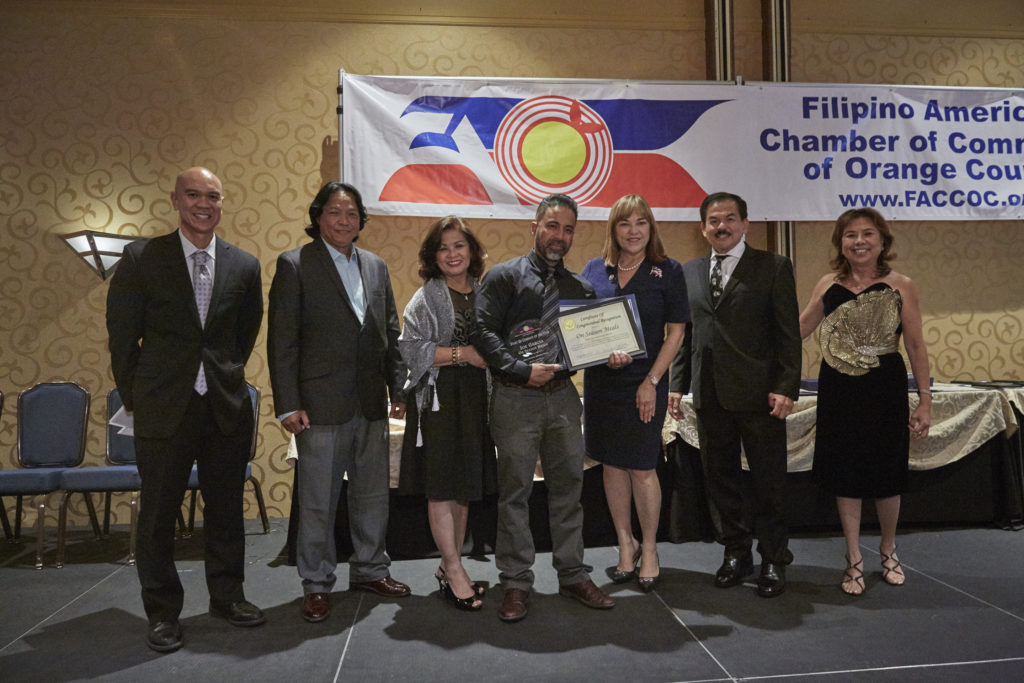 """Joe Garcia, founder of On Season Meals accepts his award """"Startup Company of the Year"""""""